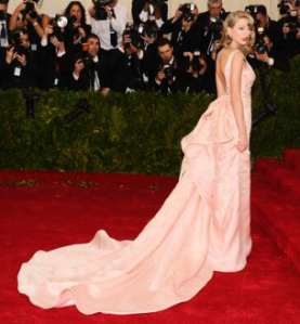 perfection falls in the place of Taylor Swift in custom made Oscar de la Renta. Thank goodness the dress survived after Swiftys kitty took its claws to it during a fitting earlier today! ultimate glam Swifty congrats.