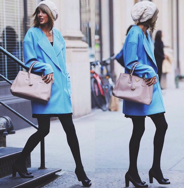 Taylor Swift wearing an ASOS boyfriend coat, Prada bag, Chanel shoes.