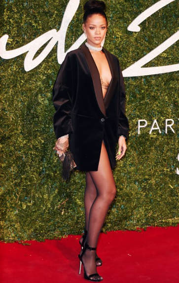 Rihanna wearing nothing but a Stella McCartney blazer photo by Rex Features