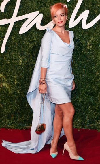 Lily Allen wearing a Vivienne Westwood (<3) Gown, House of Holland Jewels & Manolo Blahnik shoes Photo by Rex Features