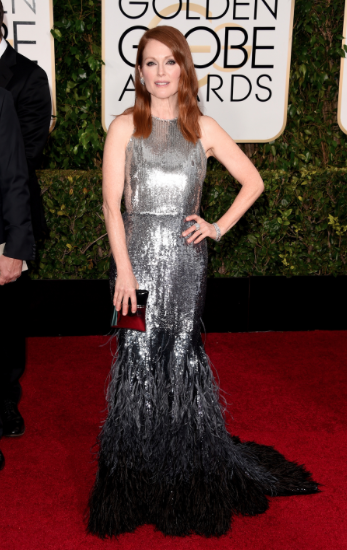 "best actress and best dressed! what a night for Julianne Moore. Nothing was as cute as her describing her involvement in making this CUSTOM Givenchy dress. ""I just told them I loved feathers"" she said with tears in her eyes. SO sweet!"