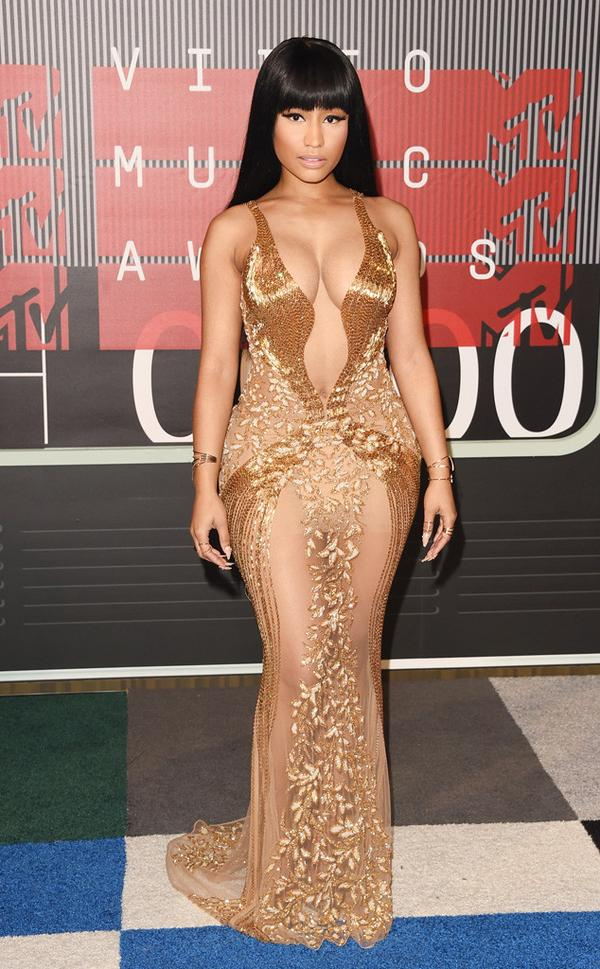 Nicki is opening the show tonight and looks extra luxurious in all gold on the red carpet. Think bond girl, think feminine. This look is just slamming! I love how her red carpet style has evolved this year.