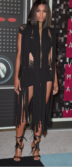 Ciara taking the fringing trend to another level yet somehow it seems to work? It's drastic but it's black so it all comes together. Outfit by Vauthier