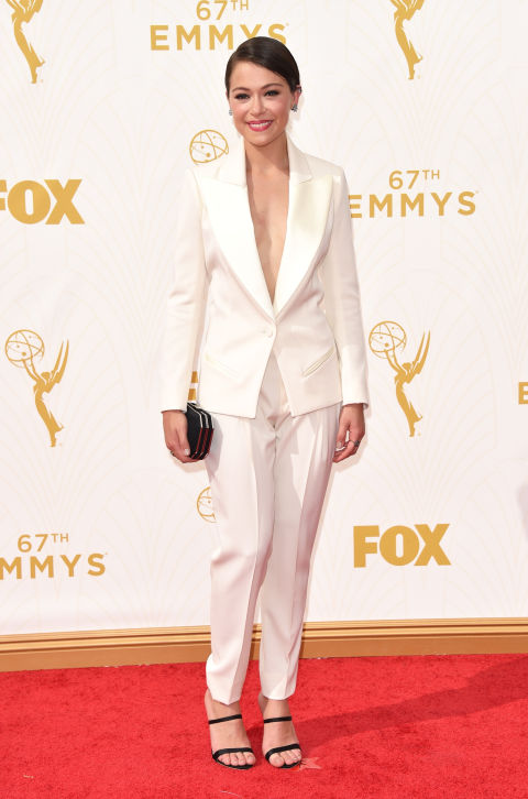 Tatiana Maslany wears a sleek white pant suit tonight and it's been a really big hit on the red carpet. I kinda think it borderlines cheap though. It's very Miley and i'm left here just like oh really another risqué pant suit at an award show really?...zzz